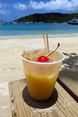 Painkiller rum cocktail on the beach in St. John, USVI, Virgin Islands, Caribbean