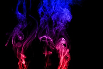 Movement of smoke,Red and blue smoke swirl on black background, Color smoke on black background
