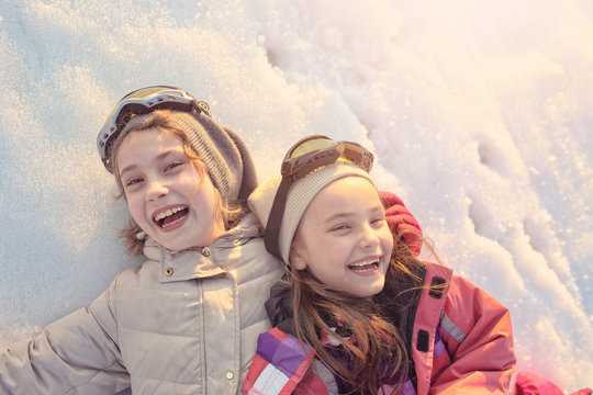 Two friends have fun on the snow
