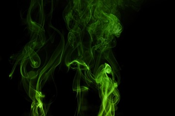 Green colored smoke on a black background, abstract cloud. Smoke design,Abstract green lighting,Green Smoke