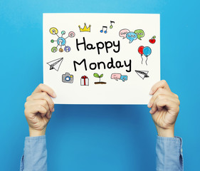Happy Monday text on a white poster on a blue background