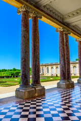 Grand Trianon columns and park garden in Palace of Versailles, Paris, France