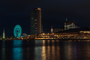 Beautiful view of Kobe Port.Night scenery of  Bay Area in Kobe City, with Landmark Tower among high rise skyscrapers with a giant Ferris wheel