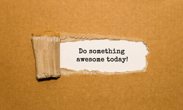 The text Do something awesome today appearing behind torn brown paper