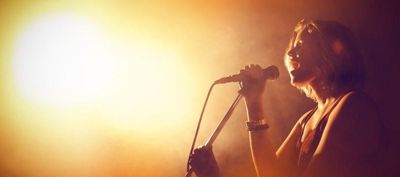 Singer performing in club