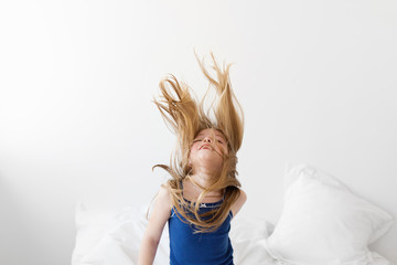 young girl with blond hair floating in the air