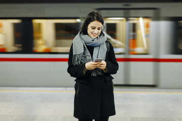 Young woman waiting train in underground