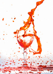 red wine splash in the glass on white background,red water drop splash on white background