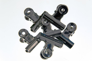 Bulldog clips holding each other