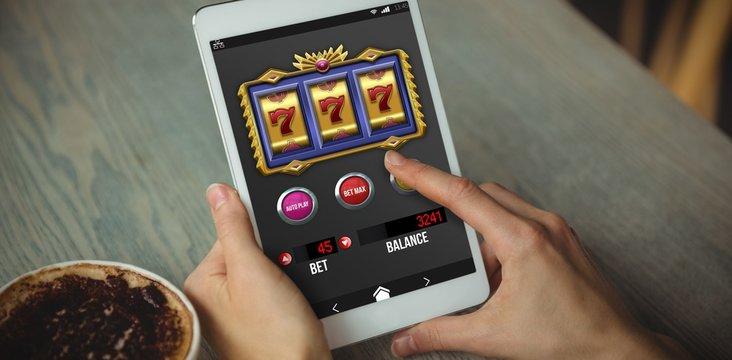 Composite image of casino slot machine app on mobile screen