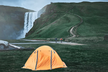 Spoed Foto op Canvas Kamperen camping near famous Skogafoss waterfall in southern Iceland. treking in Iceland. Travel and landscape photography concept