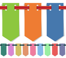 Set of single-color flags hanging on a ribbon