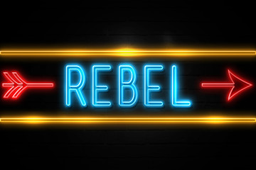 Rebel  - fluorescent Neon Sign on brickwall Front view Fototapete