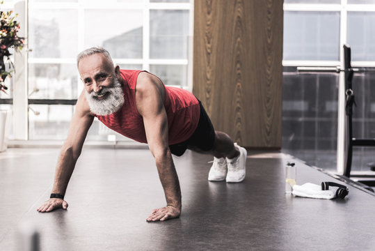 Positive pensioner is spending time in athletic center