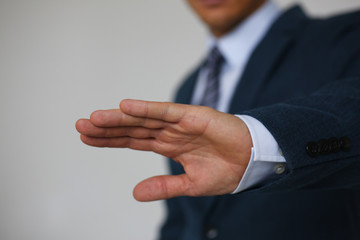 Gesture male hand rejection says no male businessman in a suit