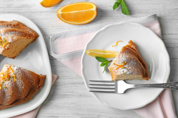 Composition with delicious citrus cake on wooden table