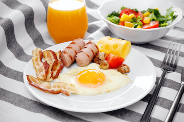 Tasty breakfast with egg on plate