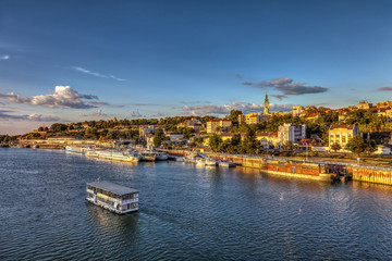 Boat on Sava and sunset over Belgrade. HDR image