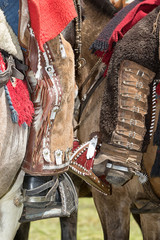 foot of cowboys equipped for rodeo with chaps and spurs