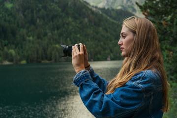 Woman taking shots on mountain lake