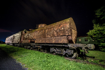 Rusty old train wagon at night