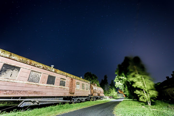 Rusty old train car with some stars in the sky