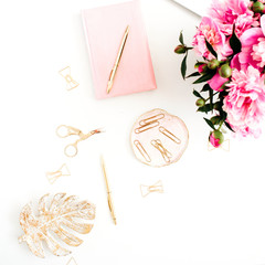 Flat lay home office desk. Woman workspace with pink peonies bouquet, golden accessories, pink diary on white background. Top view feminine background.