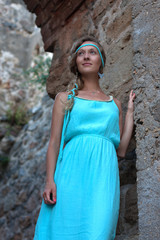 Young blonde woman with braided hear  wearing turquoise dress