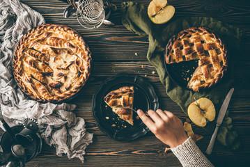 American apple pies on dark wooden table, top view