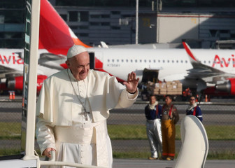 Pope Francis waves upon his arrival in Bogota, Colombia