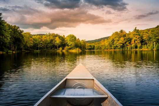 Aluminum canoe on a mountain lake upstate New York. Camping. outdoors and adventure concept.  Faded, vintage color post processed