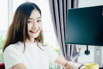 Young asian girl is freelancer with her private business at home office, working with laptop, coffee, online marketing, Customer order and packaging or packing.