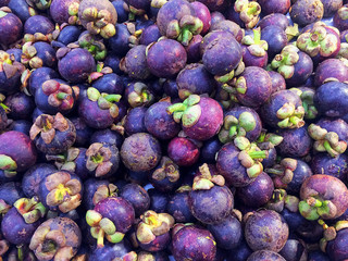 mangosteen are arranged in boxes sold in supermarket