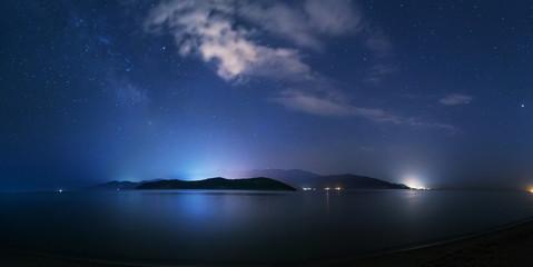 Night starry sky on the beach in Keramoti, Greece