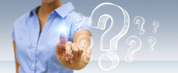 Businesswoman touching hand drawn question marks