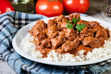 Chicken tikka masala served with rice