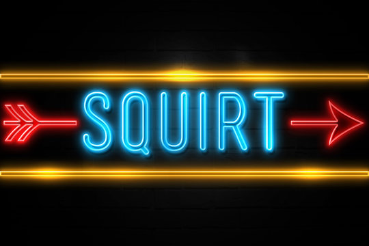 Squirt  - fluorescent Neon Sign on brickwall Front view