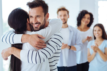 Positive happy people hugging each other Wall mural
