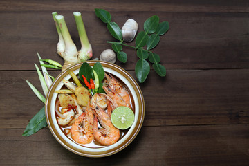 Tom Yum Kung Shrimp clear soup with herb ingredient, Thai food, top view.