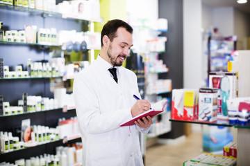 Pharmacist checking drugs in pharmacy
