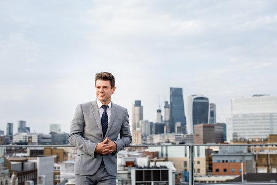 Businessman with London city skyline