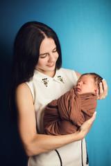 newborn baby mom hands on