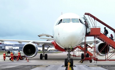 Passenger boarding airplane from front view