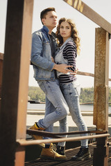 Young beautiful fashion couple wearing jeans clothes in daylight. Love concept.