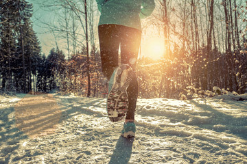 Stores à enrouleur Glisse hiver Woman Running at snowly winter under sunlight.