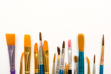 Paint brushes isolated, used artist tools with copy space