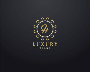 Luxury letter H monogram vector logo design. mandala and ornamental logo.