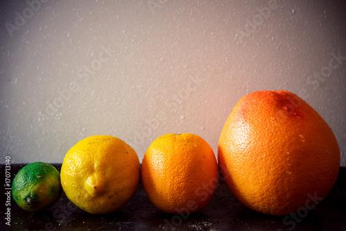 sliced citrus fruits vitamins oranges grapefruits limes juicy