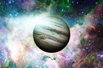 Planet Jupiter. Nebula on the background. Elements of this image furnished by NASA.