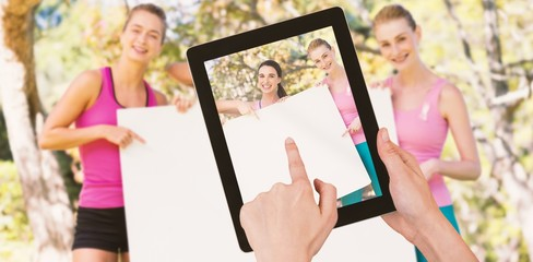 Composite image of hands touching digital tablet against white